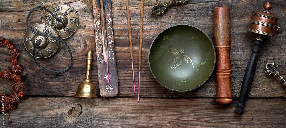 Fototapeta Tibetan singing bowl and other religious ritual instruments for meditation