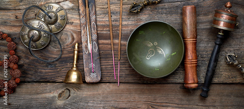 Obraz Tibetan singing bowl and other religious ritual instruments for meditation - fototapety do salonu