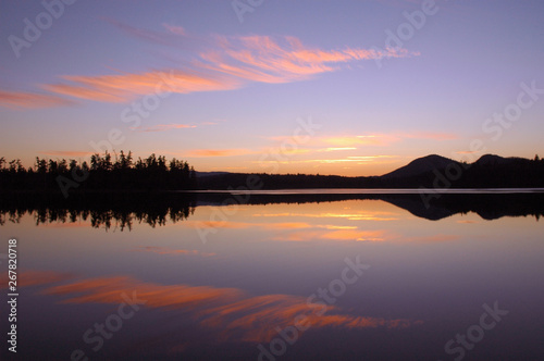 Tuinposter Baksteen Sunset over Barnum Pond in the Adirondack Mountains with sky and mountains reflecting in calm water