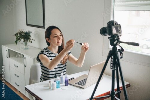 Fotografija  A beauty blogger or video blogger tells and shows subscribers how to do makeup