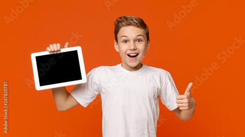 Stampa su Tela Teenage boy showing blank digital tablet screen
