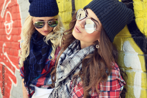 Fotografie, Tablou  Young pretty hipster girls having fun outdoor, summer on the street