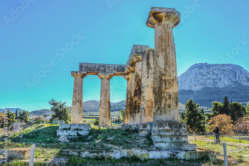 Fotografie, Tablou Columns in ruins of Temple of Apollo with Acrocorinth the acropolis of ancient C