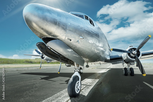 historical airplane on a runway ready for take off Wallpaper Mural
