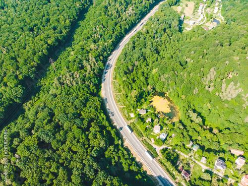 Foto op Plexiglas Groene overhead view of highway near village