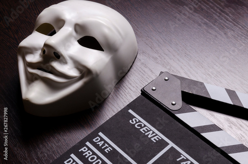 Fotografie, Obraz  Movie clapperboard and white mask