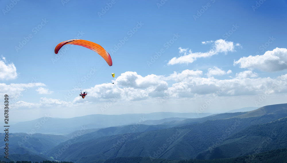 Fototapety, obrazy: Paraglider in the blue sky.