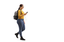 Female Student Walking And Choosing A Song From Her Mobile Phone