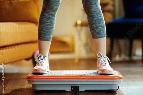 Fotografie, Obraz  Closeup on young woman training using vibration power plate