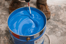 Bucket Of Blue Paint Mixing On Motion