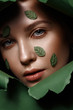 canvas print picture - Beautiful fresh girl with perfect skin, natural make up and green leaves. Beauty face. Close up