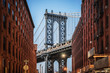 Dumbo - The famous Manhattan bridge between two red brick buildings in Brooklyn - New York City, NY