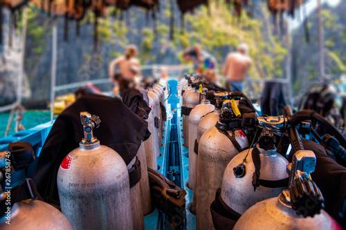 Scuba divers getting ready for diving on a boat full of equipment, Thailand Tapéta, Fotótapéta