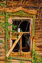 Broken Window Of Old Wooden House In Folk Russian Style