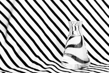 Single Science Flask With Water With Creative Black White Zebra Hypnotic Illusion Pattern Background