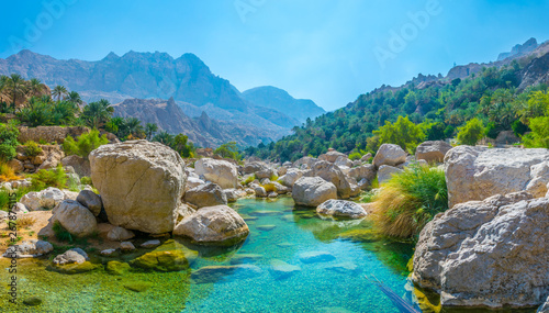 Lagoon with turqoise water in Wadi Tiwi in Oman. - 267875115