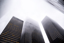 Looking Up The Toronto Financial District In City Downtown With Misty Sky