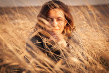 Outdoor Close Up Portrait Of Young Beautiful Woman N Brown Knit Sweater Made Of Natural Wool And Jeans Posing On Field In Autumn Park.  Autumn Walking Concept.