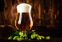 Beer Glass On Dark Wooden Back...