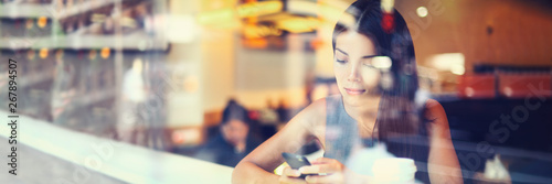 Fotografering  Mobile phone woman using smartphone texting in city cafe urban businesspeople lifestyle banner panorama
