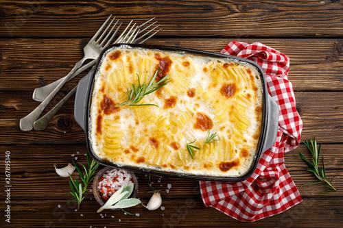 Potato gratin. Baked potato with cream, cheese and garlic Canvas Print