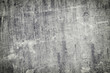 Gray abstract background with scratches and irregularities. Old worn slate sheet. The basis for the layout.