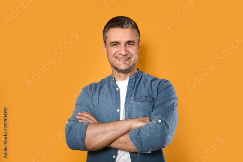 Obraz Portrait of handsome mature man on color background - fototapety do salonu