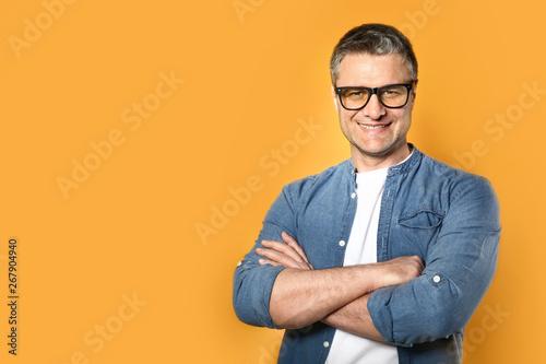 Fotografie, Obraz  Portrait of handsome mature man on color background