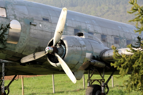 Left rotary engine of Douglas Dakota DC-3 WWII plane placed in field at exhibit Canvas Print