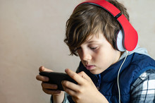 Fascinated Fashionable Teenager Playing An Internet Game. Of Dependence Children From Online Games. Internet Addiction