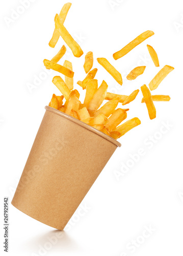 fries spilling out of a take-out paper cup tilted on white background Fototapeta