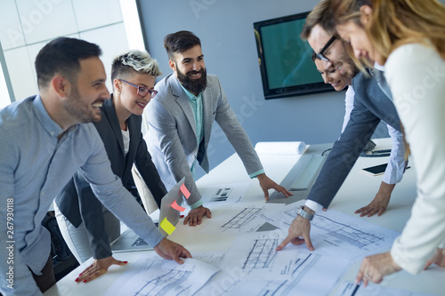 Fototapety, obrazy: Team of architects working on construction plans