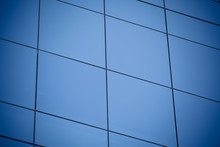 Modern Office Building With Blue Glass Windows