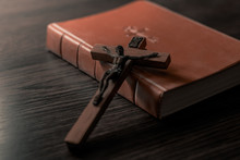 Old Holy Bible And Crucifix. C...