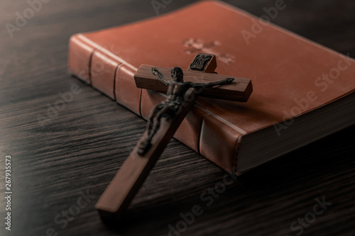 Photo Old Holy Bible and Crucifix. Concept for religious events