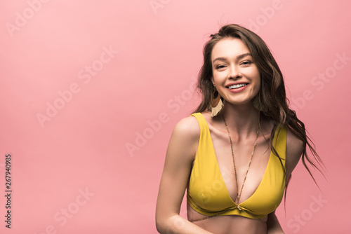 Obraz smiling young woman in yellow swimsuit isolated on pink - fototapety do salonu