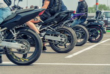 Four Motorcycles Are Unlikely. Rear Wheels Of Motorcycles Close Up