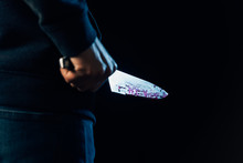 Cropped View Of Murderer Holding Knife Isolated On Black