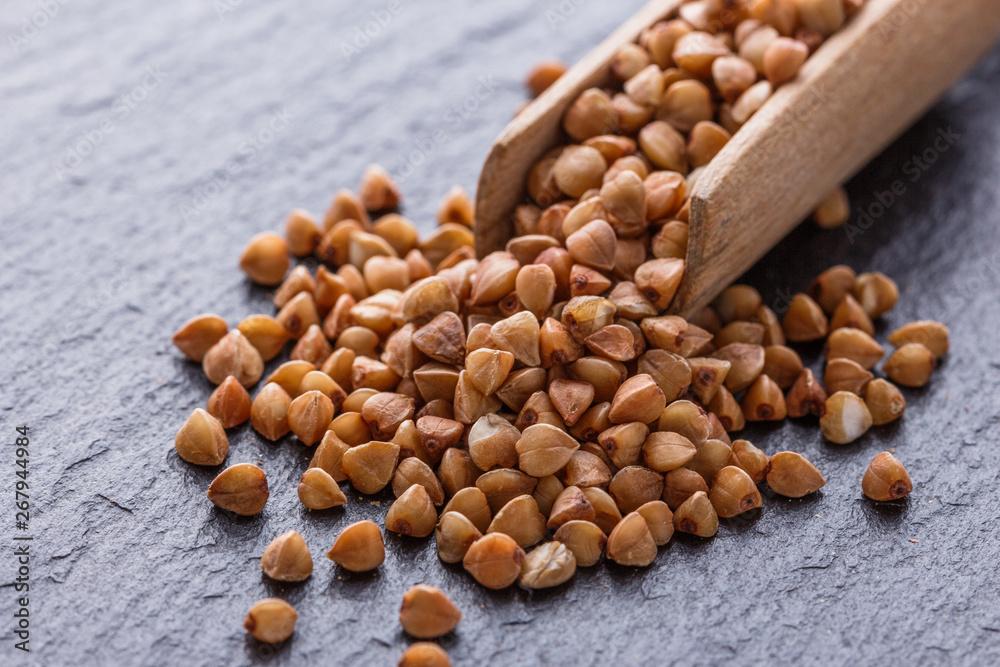 Fototapety, obrazy: Grain buckwheat on a dark stone background