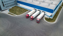 Trucks Are Loaded In A Modern Logistics Center