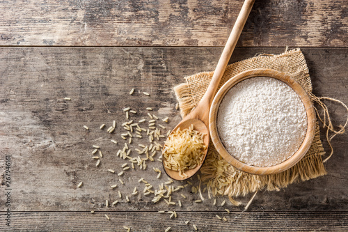 White rice flour in a bowl on wooden table. Top view. Copyspace Fototapeta