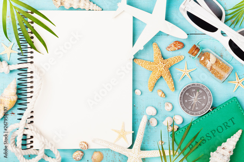 Photo sur Aluminium Kiev Planning summer holidays, trip, travel and vacation background. Open notebook with accessories on blue table top view. Flat lay style.