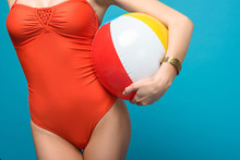 Cropped View Of Woman In Swimsuit Holding Inflatable Beach Ball Isolated On Blue