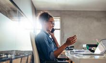 Businesswoman In Conversation Over Phone