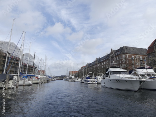 Photo  Copenhagen, Denmark - March 2019: Yachts moored along the canal of the city