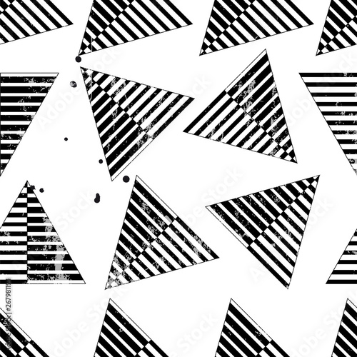 seamless background pattern, with triangles, stripes, strokes and splashes, black and white