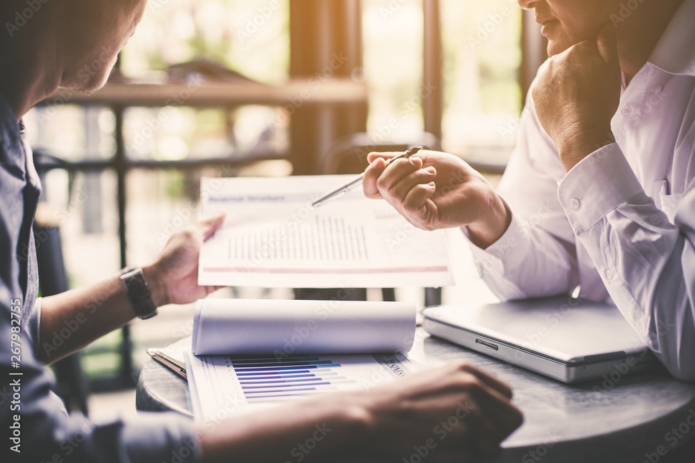 Fototapeta Discussing plan and idea to improvement strategy, businessmen brainstorming for strategy of business investment,businessmen review chart and document of investment information
