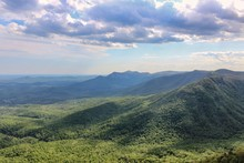 Stunning Caesars Head Viewpoint On A Surrounding Mountains, Table Rock Reservoir And Mountain And Sunlit Forest