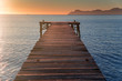 Pier in beautiful summer sunrise light. Warm orange colors, Mallorca, Spain