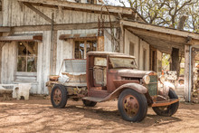 Old Rusty Truck And An Old Abandoned Barn